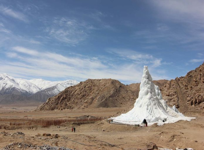 XXII Triennale, Broken Nature: Design Takes on Human Survival. Students' Educational and Cultural Movement of Ladakh - SECMOL (Sonam Wangchuk), Ice Stupa. 2013-14, artificial glacier designed to counter climate change consequences in the region of Ladakh. Photo: Lobzang Dadul. Courtesy SECMOL.