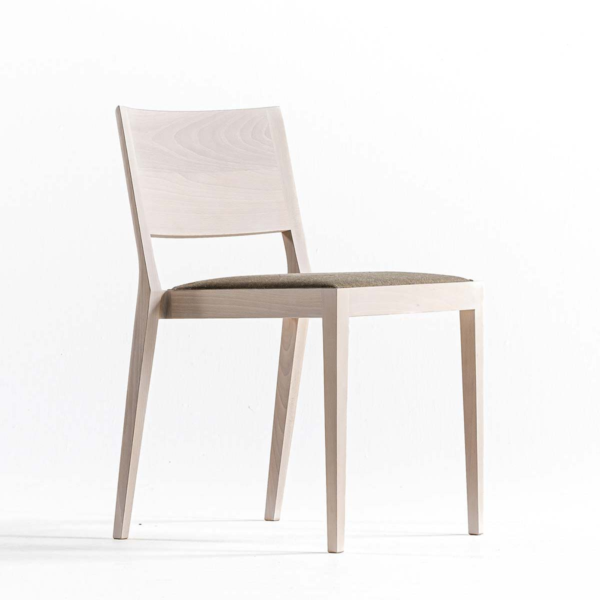 A chair in the forest by Time & Style