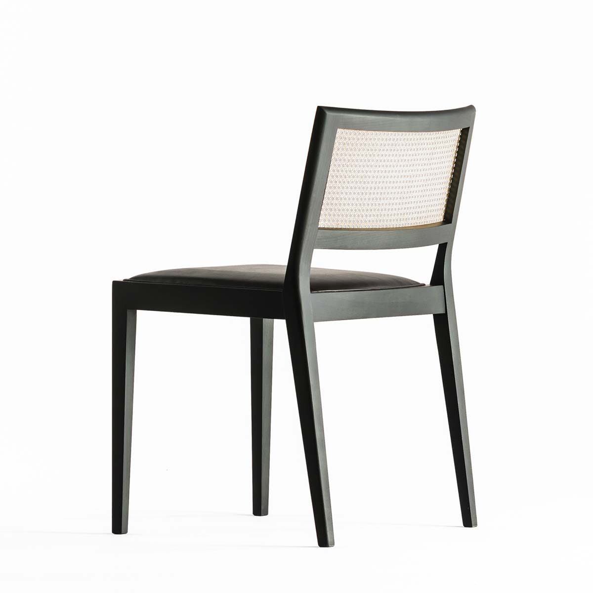 A chair outside the cage by Time & Style